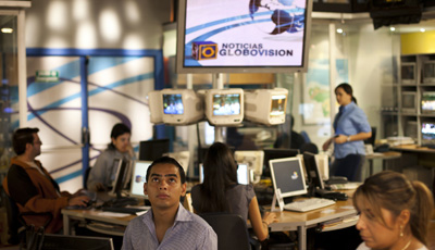 Journalists at work in Globovisión's main studio. Reporters from the station were attacked and threatened at a rally on Sunday. (Reuters/Carlos Garcia Rawlins)