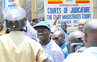 Three Ugandan journalists were beaten and detained by police on Wednesday while covering the release of opposition leader Kizza Besigye, seen here outside the court. (AFP/Isaac Kasamani)