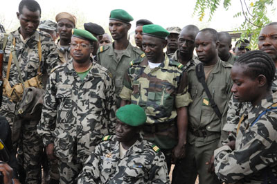 Mali junta leader Captain Amadou Sanogo, center, poses surrounded by fellow soldiers in Bamako Thursday. (AFP/Habibou Kouyate)