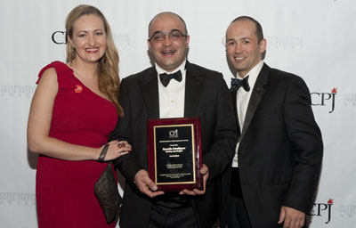 Eynulla Fatullayev, center, is pictured with CPJ's Europe and Central Asia program coordinator, Nina Ognianova, and research associate Muzaffar Suleymanov at the 2011 International Press Freedom Awards in New York. (CPJ)