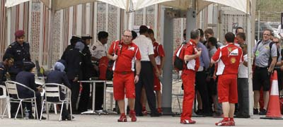 Police check journalist IDs outside the Formula One races on Sunday. Authorities have restricted and suppressed journalists in the run-up to the races. (AP/Hassan Ammar)