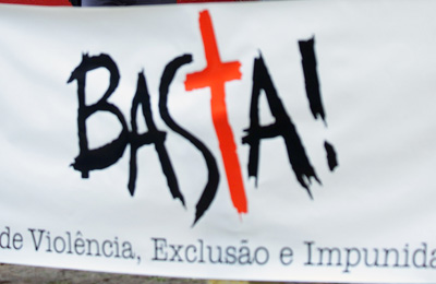 """At a protest against the murder of a journalist in Sao Paulo, Brazil, a sign reads: """"Enough of violence, exclusion and impunity."""" (AP/Dario Lopez-Mills)"""
