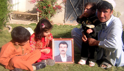 Journalist Hayatullah Khan, shown in the picture above surrounded by his family, was killed in 2006. (AP/Abdullah Noor)
