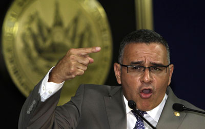 Salvadoran President Mauricio Funes denies that his government has engaged in negotiations with gangs to lower the rate of homicides. (AP/Luis Romero)