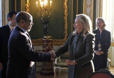U.S. Secretary of State Hillary Clinton meets Ethiopian Prime Minister Meles Zenawi at a conference in London in February. Western governments are hesitant to press Ethiopia on human rights abuses. (AP/Jason Reed)