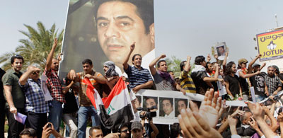 In Baghdad, protesters seek justice in the murder of  Hadi al-Mahdi. (AP/Karim Kadim)