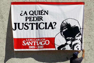 A banner seeks justice for  photographer Luis Carlos Santiago, whose case is among 11 unsolved murders over the past decade. (Reuters/Tomas Bravo)