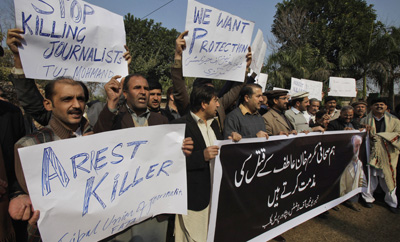 Pakistani journalists rally against the killing of their colleague Mukarram Khan Atif. No arrests have been made in the case. (AP/Mohammad Sajjad)