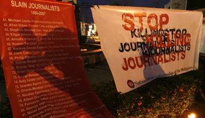 A poster of names lists journalists slain in the Philippines since 1986. (Reuters/Romeo Ranoco)