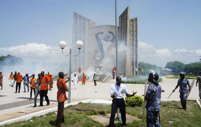 Police spray tear gas at protesters Friday at Togo's Independence Plaza. (ANC Togo)