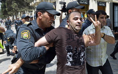 Police in Baku arrest a man during a protest seeking reforms in conjunction with Eurovision. (DAPD/Joern Haufe)