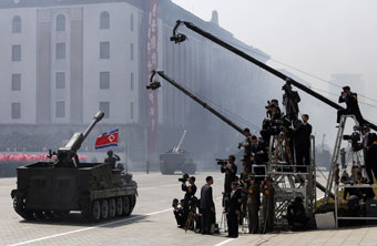 A North Korean tank moves past local journalists during an April military parade in Pyongyang. (AP/Ng Han Guan)
