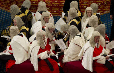 The judicial Law Lords await the Queen's speech to lawmakers in London May 9, when libel reform was part of the government legislative agenda introduced by the monarch. (Reuters/Alastair Grant)