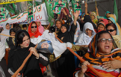 Supporters of a Pakistani opposition party carry effigies of Prime Minister Yousuf Raza Gilani and President Asif Ali Zardari at a protest rally in Multan on May 11. (AFP/S.S. Mirza