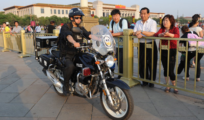 A police officer patrols as part of heavy security at Tiananmen Square in Beijing. (AFP/Mark Ralston)