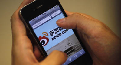 An Internet user visits a Sina Weibo site. (Reuters/Carlos Barria)
