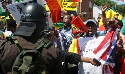 Police try to restrain Ethiopian demonstrators protesting near the G8 Summit at Camp David over the weekend. (AP/Timothy Jacobsen)