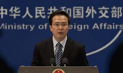 In a press conference today, Ministry of Foreign Affairs Spokesman Hong Lei, above, evaded questions about Al-Jazeera being denied journalist visas. (AP/Andy Wong)