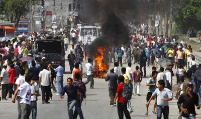 Protesters set fire to a motorcycle during the three-day strike in Nepal. (Reuters/Navesh Chitrakar)