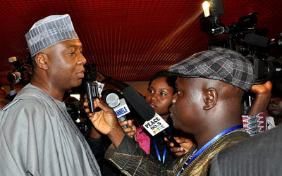 Police shielded parliamentarian and former state governor Bukola Saraki, left, from journalists after he was questioned by a police fraud unit. (247nigerianewsupdate.com)