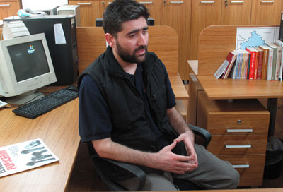 Turkish journalist Adem Özköse, pictured Monday at the Istanbul office of his newspaper Milat, and freelance cameraman Hamit Coşkun were released Saturday from detention in Syria. (AP/Chris Torchia)