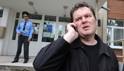 Andrzej Poczobut, seen here outside a courthouse in 2011, has been arrested and charged with libel. (AFP/Kseniya Avimova)