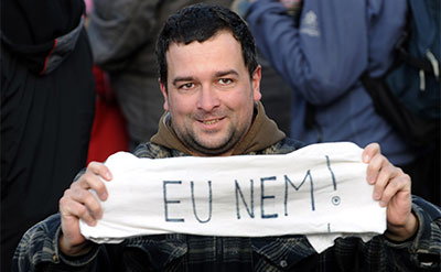 A Hungarian holds a banner reading 'EU No!' in Budapest on March 15, 2012, during a commemoration of the 1848-1849 Hungarian revolution and independence war. (AFP/Attila Kisbenedek)