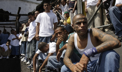 Mara Salvatrucha gangsters attend mass in prison. Members of the gang have been charged with the murder of a journalist. (AP/Luis Romero)