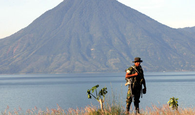 A soldier patrols a lake in the town of Panajachel, where journalist Lucía Escobar used to live. (AFP/Orlando Sierra)