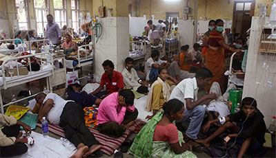 Patients suffering from malaria crowd a ward of a government hospital in India. (AP/Rafiq Maqbool)