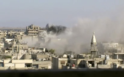 An image released by the Shaam News Network shows heavy shelling in Homs. At least five journalists were killed in Syria at the end of May, two of them in Homs. (AP/Shaam News Network)
