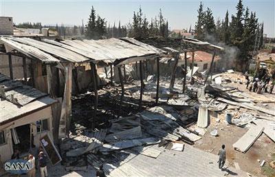 Gunmen attacked Al-Ikhbariya TV this morning, destroying the offices and killing staff members, according to state media. (AP/SANA)