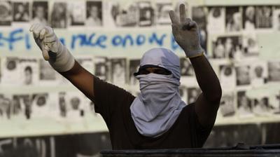 A protester in Jidhafs, Bahrain. (AP/Hasan Jamali)