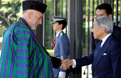 Afghan President Hamid Karzai, left, is welcomed by Japan's Emperor Akihito in Tokyo in 2010. Japan is one of Afghanistan's biggest donors. (AP/Koji Sasahara)