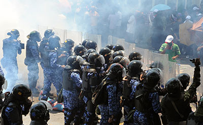 Maldivian riot police clash with supporters of ousted President Mohamed Nasheed in Male in March. (AFP)