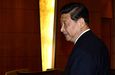 Xi Jinping's youth is the subject of an article that may be related to a newspaper editor's reassignment. Xi is expected to be China's next president. (AP/Jason Lee)