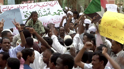 A screen shot from AFP TV shows Sudanese demonstrators protesting in Khartoum on Friday. (AFP)