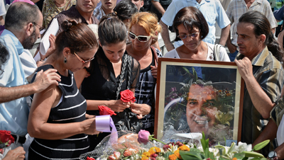 Hundreds attended the funeral of Oswaldo Payá, a Cuban activist, on Monday. (AFP/Adalberto Roque)