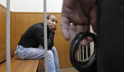 Retired police lieutenant colonel Dmitry Pavlyuchenkov, seen here in detention in 2011, was indicted in the Politkovskaya murder today. (Reuters/Sergei Karpukhin)