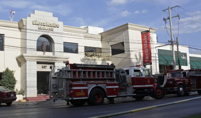 Fire trucks park outside Sierra Madre. (Reuters/Daniel Becerril)