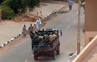 Sudanese security forces pass through a Khartoum street on Monday. (AFP/Ian Timberlake)