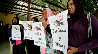 Sudanese journalists protest the recent crackdown on the press. (AFP/Ashraf Shazly)