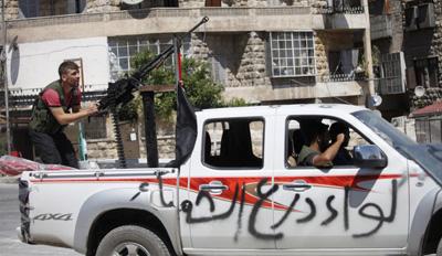 A rebel fighter trains an anti-aircraft machine gun in Aleppo. (Reuters/Zain Karam)