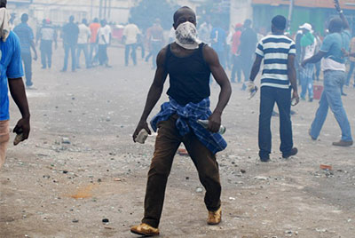 Clashes broke out in Gabon's capital Libreville on Wednesday when police broke up a protest in support of the country's main opposition leader. (AFP/Xavier Bourgois)