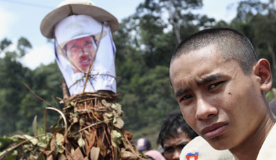 Chut Wutty's son stands near a picture of his father during a commemoration ceremony. (Reuters/Samrang Pring)
