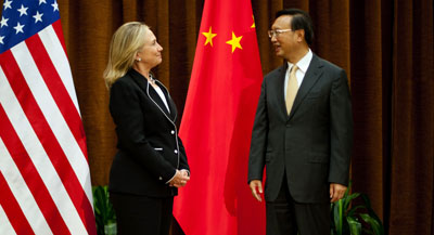 Chinese Foreign Minister Yang Jieche greets U.S. Secretary of State Hillary Clinton in Beijing. (AFP/Jim Watson)