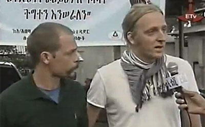 Swedish journalists Johan Persson and Martin Schibbye appear on state television. (ETV/YouTube)