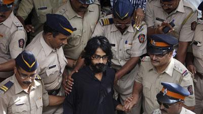 Cartoonist Aseem Trivedi, center, has been charged with sedition. (AP/Rafiq Maqbool)