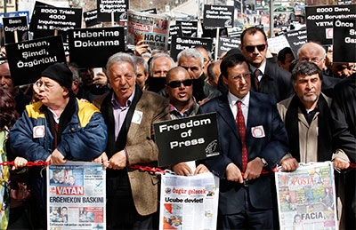 Journalists and activists call for press freedom in Ankara on March 19, 2011, after the arrest of 10 journalists as part of investigations into the alleged Ergenekon plot. (Reuters/Umit Bektas)