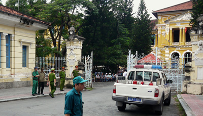 Police stand outside the entrance of the court where three bloggers were convicted and sentenced on anti-state charges today. (AFP)